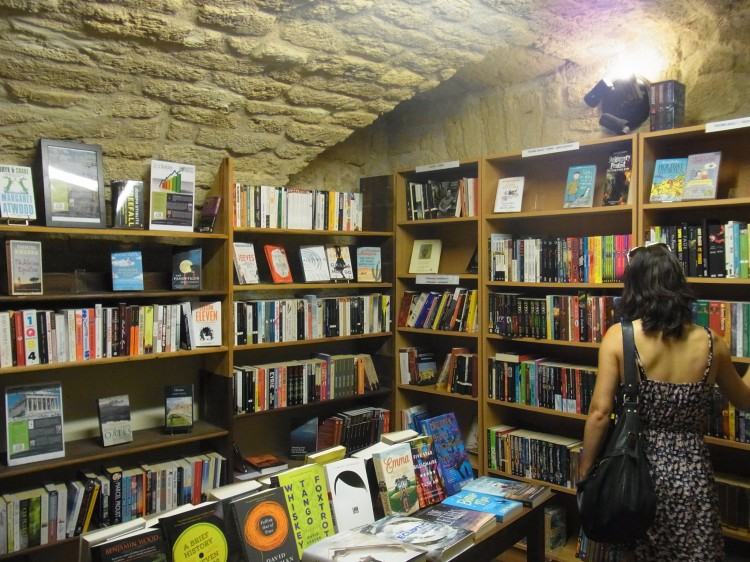 Welcome to the YA section of the bookshop, what you were all waiting for. Beautiful shelves, and still those amazing stone walls, making us feel like we're in a whole other universe.